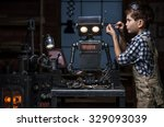 young boy mechanic repairing... | Shutterstock . vector #329093039