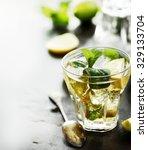 mojito cocktail on dark table... | Shutterstock . vector #329133704