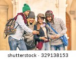 Stock photo group of young hipster tourists friends having fun with smartphone in the old town traveling 329138153