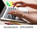 woman using laptop on workplace ... | Shutterstock . vector #329163050