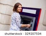 Young Woman At The Cash Machine