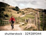 mountain biker riding on bike... | Shutterstock . vector #329289344