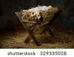 Manger With Hay And Swaddling...