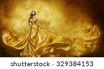 Small photo of Gold Fashion Model Dress, Woman In Golden Silk Gown Flowing Fabric, Beautiful Girl on Stars Sky looking up