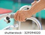 old senior hands holding on to... | Shutterstock . vector #329394020