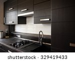Stock photo beautiful brown kitchen in a modern style 329419433
