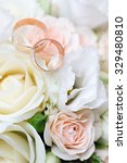 gold wedding rings on a bouquet ... | Shutterstock . vector #329480810