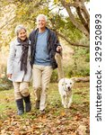 Stock photo senior couple in the park on an autumns day 329520893