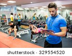 handsome trainer using tablet... | Shutterstock . vector #329554520