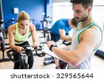 fit people in a spin class at... | Shutterstock . vector #329565644