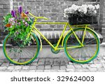 green bicycle with flowers.... | Shutterstock . vector #329624003