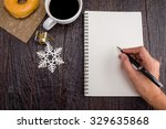 asian woman holding pen write... | Shutterstock . vector #329635868