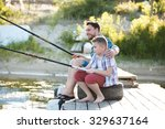 man and boy fishing on the lake ... | Shutterstock . vector #329637164