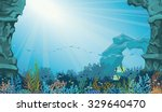 Coral Reef With School Of Fish...