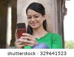 Woman Smiling While Reading An...