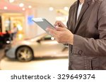 young businessman using tablet... | Shutterstock . vector #329649374