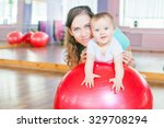 mother with happy baby doing... | Shutterstock . vector #329708294