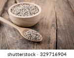 pepper in a bowl on wooden... | Shutterstock . vector #329716904