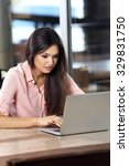 young woman working with laptop ...   Shutterstock . vector #329831750
