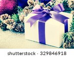 christmas gift tied with purple ... | Shutterstock . vector #329846918