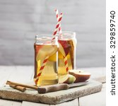 apple spiced drink with cinnamon | Shutterstock . vector #329859740