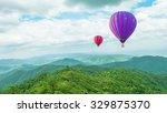 balloon on mountain background   Shutterstock . vector #329875370
