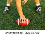 Player ready to hike the football - stock photo