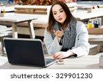 attractive woman  wearing in... | Shutterstock . vector #329901230