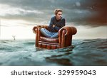 man on a seat lost at sea | Shutterstock . vector #329959043