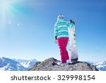 back view of female snowboarder ... | Shutterstock . vector #329998154