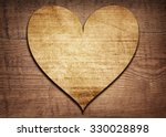 Wooden Heart Placed On A Brown...