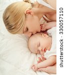 young mother and her baby ...   Shutterstock . vector #330057110