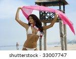 fashion model in bikini on the... | Shutterstock . vector #33007747
