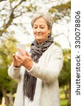 senior woman in the park on an... | Shutterstock . vector #330078806
