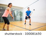 couple play some squash... | Shutterstock . vector #330081650