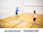 couple playing a game of squash ... | Shutterstock . vector #330083180