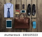 business clothes on a wooden... | Shutterstock . vector #330105323