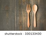 wooden spoon and wooden fork on ... | Shutterstock . vector #330133430