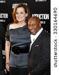 Small photo of Sigourney Weaver and John Singleton at the Los Angeles premiere of 'Abduction' held at the Grauman's Chinese Theatre in Hollywood, USA on September 15, 2011.