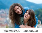 two women friends laughing and...   Shutterstock . vector #330300263