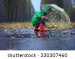 Toddler And Umbrella In Autumn...