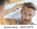 middle aged man concerned by... | Shutterstock . vector #330511979