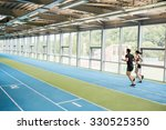Couple Running On The Indoor...