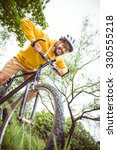 handsome man with mountain bike ... | Shutterstock . vector #330555218