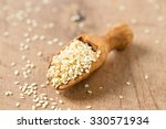 Stock photo sesame seeds in a wooden scoop 330571934