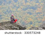 A Young Woman Sitting On The...