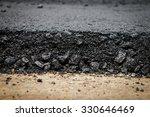Close Up Asphalt At The Road...
