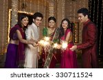 friends playing with sparklers | Shutterstock . vector #330711524