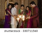 friends playing with sparklers | Shutterstock . vector #330711560