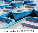 group of blue rowboat at river | Shutterstock . vector #330767054